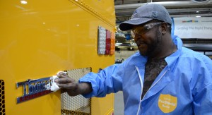 UAW members at five Daimler Trucks North America facilities, including at Thomas Built Buses, were able to secure a common agreement in 2014 because of the solidarity shown by the membership. Photo credit: PHOTO BY DENN PIETRO