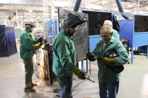 Vets participating in the program at the UAW-Ford TTC speak with their instructor.
