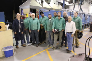 Veterans and instructors pose for a photo at the UAW-Ford TTC