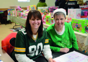 Julie Caldwell and Juli Baird were two of the volunteers who helped organize the toy giveaway for Local 833 members in December.