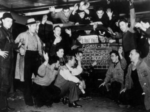 General Motors' workers celebrate the end of the historic Flint Sit-Down Strike in 1937. As a result, 100,000 workers gained the right to union representation.
