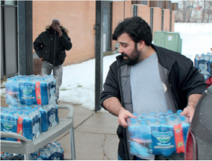 UAW Local 651 President Alex Leafi delivers water to the Brennan Community Center in Flint.