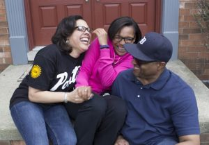Kim, left, and Roy Gomillion enjoying a moment with daughter Faith. (Photo Credit: Denn Pietro, UAW)