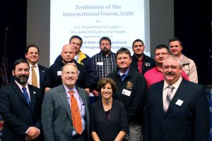 Ten UAW members from around the country testified before OSHA in support of the new standard for crystalline silica. First row from left: Andrew Comai, UAW International Health and Safety Department, Local 174; Deputy Assistant Secretary of Labor for Occupational Safety and Health Jordan Barab; Deborah Berkowitz, former OSHA chief of staff and Senior Fellow of Worker Health and Safety for the National Employment Law Project; Shawn Ragle, Local 974, Mapleton, Illinois. Second row: Darius D. Sivin, UAW International Health and Safety Department; Rodney Graves, Local 2317, Lafayette, Indiana; Jeff P'Poole, Local 523, Calvert City, Kentucky; Andrew Mercer, Local 8, Sparta, Michigan. Third row: Stan Burkeen, Local 523, Calvert City, Kentucky; Matthew Wafford, Local 2339, Rushville, Indiana; Richard Boecker, Local 211, Defiance, Ohio; Robert Hitchcock, Local 211, Defiance, Ohio. Not pictured: Greg Essex, Local 226, Indianapolis.