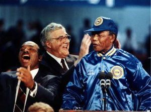 Ernie Lofton, left, shares a moment with UAW President Owen Bieber and Nelson Mandela when Mandela arrived in Detroit in 1990 to thank UAW members for helping to fight apartheid in South Africa.