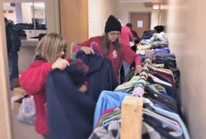 Dawn Tree, left, and Donna Ball of Local 1268, go through donated clothing so veterans have something warm to wear this winter.