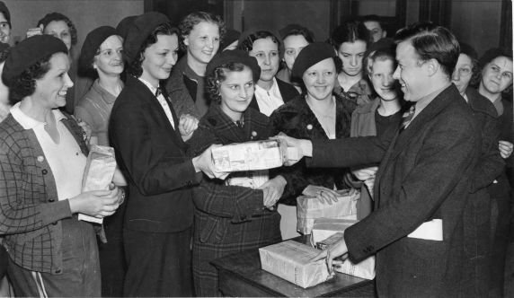 Walter Reuther distributes packets of leaflets to members of the UAW Women's Auxiliary Brigade for distribution at the Ford Rouge Plant, two hours prior to the Battle of the Overpass.