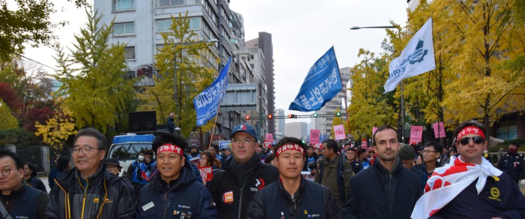 UAW members marching in support of Han and against corruption in the South Korean government